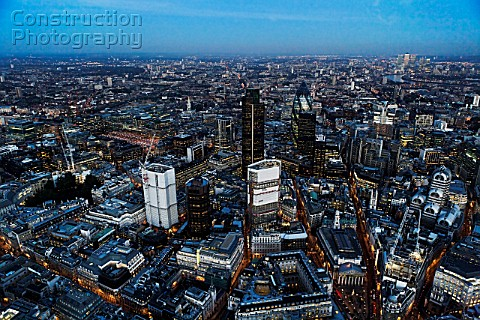 Aerial view of City of London skyline at night UK