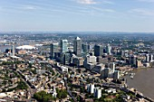 Aerial view of Canary Wharf, Docklands, London, UK. Also known as Isle of Dogs. Millennium Dome and Thames Barrier in