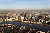 Aerial view of Canary Wharf, Docklands, London, UK. River Thames in foreground