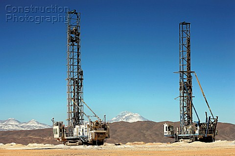 Drilling Machines and Volcano Llullaillaco at Escondida Norte
