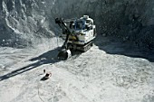Man leaves Electric Shovel in Copper Mine in Chile preparing the Blasting