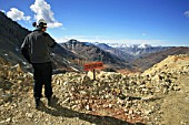 Geologist Next To Explosive Sign In The Andes Looks To Argentina.  At 4000 m High They have The Best View To Argentina