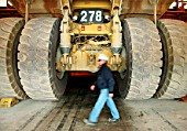 Inspector Walking Through Dumper Truck Workshop n Escondida The Largest Single Mine Copper Producer InThe World