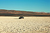 Pick-Up driving Through the Salt Flat Of Punta Negra