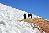 Three Miners Walking Next To Glacier In The Andes, Chile
