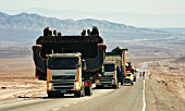 Trucks Transporting Parts Of An Electric Shovel On The Highway That Conects Antofagasta With Escondida, Chile
