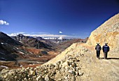 Two Miners Walk Through The Exploration Road In The Andes.  At 4000 m High They have The Best View To Argentina