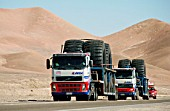 Trucks Carrying Oversize Tires, Wide Load sign from Antofagasta to Escondida Copper Mine
