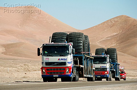 Trucks Carrying Oversize Tires Wide Load sign from Antofagasta to Escondida Copper Mine