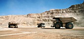 Three Dumper Trucks moving in Escondidas copper open cast mine, Chile