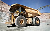Dumper Truck moving to Electric Shovel to be loaded in copper open cast mine Escondida, Chile