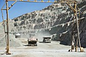 Dumper Trucks transporting ore out of copper open cast mine Escondida, Chile
