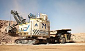 Electric Shovel loading Dumper Truck in copper open cast mine Escondida, Chile