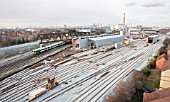 A low-level aerial view of the new rail maintenance depot at New Cross Gate, South London on 21 January 2009 showing the depot under construction and a South Central service passing under the recently installed flyover.  It is a joint venture between Balfour Beatty/Carillion to serve the extended East London Line.  The line will form part of the London Overground Network, running from Dalston Junction and Highbury an dIslington in the north to Crystal Palace and West Croydon in the South and is due to open summer 2010. The depot includes maintenance and cleaning facilities for the new trains that will run on the route.