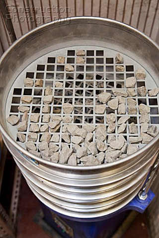 Sieves showing the different size materials from a test sample separated during the aggregate sievin