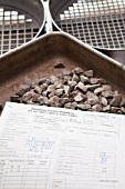 Test sample of aggregate with test sheet following aggregate sieving in the Surrey County  Council Roads department laboratory in Guildford, Surrey.