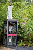 A telephone box powered by solar energy at the Center for Alternative Technology at Machynlleth, Powys, Wales, UK