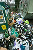 A full bottle bank overflowing with bottles to be recycled. Ambleside UK