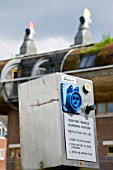 An electric car charging point at Bedzed the UKs largest eco village Beddington London UK