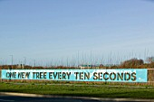 A sign about planting trees in the North west of England near Liverpool