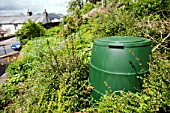 A compost bin in a garden in Ambleside, Lake District, UK. Composting your green waste prevents grennhouse gas emissions as food waste in landfill decays to emit methane, a potent greenhouse gas.