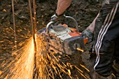 Builder using an angle grinder