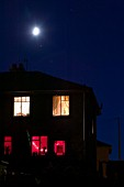 A moon and house at night Ambleside UK