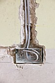 Wiring a plug socket into a house wall UK