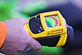 A man uses a thermal imaging camera to test how dried out a Carlisle house is after the floods