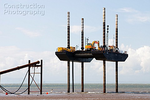 A jack up barge working on the foreshore of the Solway Firth near Workington installing the power ca
