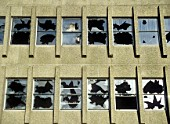 Smashed windows in a derelict building in oldham, lancashire, UK.