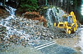 The A591 road blocked at Thirlmere by a landslide caused by extreme weather. Such extreme weather events are becoming more common as a result of climate change and leading to more damage. Lake district, UK