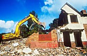 Demolishing old council houses on the Raffles sink estate in Carlisle, Cumbria, UK