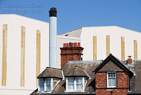 BAE systems buildings overshadowing old terraced houses in Barrow in Furness Cumbria UK