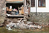 The November 2009 floods in Cumbria caused  £ millions of damage, This house in Keswick next to the River Greta, collpased after it was undermined by the flood waters.