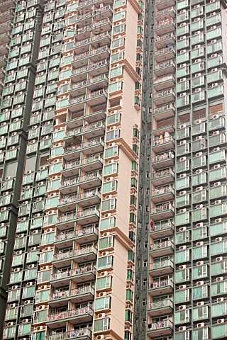 Flats in Kowloon Hong Kong with air conditioning units As temperatures rise across the world more pe