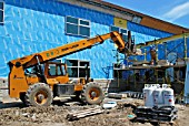 Telescopic forklift at construction site of Primary school, Ottawa, Ontario, Canada