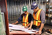 workers reviewing the plans, In Progress; Aecon Construction, job site, Ottawa; Ontario