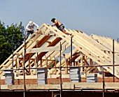 House building A frame roofing timbers brick built house