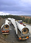Blades for wind turbines arrive at Cern Croes wind farm in Mid Wales October 2004.  Blades are transported two to a lorry in a convoy of three lorries.  Turbine capacity is 1.5MW. Wales, UK