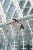 14 October 2009 - Valencia, Spain - Maintenance workers equipped with climbing gear are cleaning the glass facade of the Hemisferic. The Building is part of spanish architect Santiago Calatravas Ciudad de les Arts i Ciences/Ciudad de los Artes y Ciencias (City of the Arts and Sciences), a site comprising several edifices that he designed, located in the former bed of the Turia river, in Valencia.