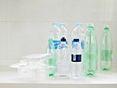 Empty plastic bottles and containers ready for recycling