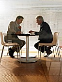 Two businessmen having meeting in a café. Alicante, Spain.