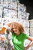 Woman at a recycling plant.