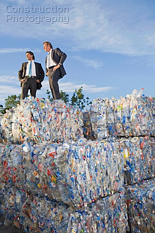 Business men outdoors at a recycling plant