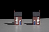 Model of a terraced brick house split into two.