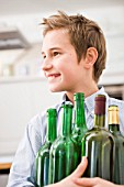 Boy recycling empty bottles