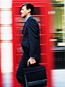 Blurred businessman walking