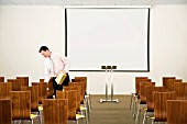 Businessman setting up seminar