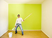 Man rocking while painting a room